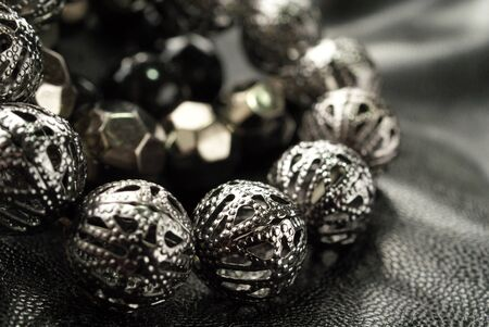 Dark Silver Bead Bracelets over black, shallow depth of field, suitable for backgrounds  photo