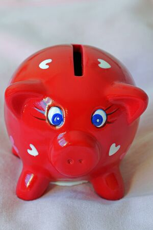 Red piggy bank decorated with hearts  photo