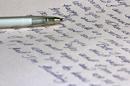 write a letter: A hand written letter with a silver ballpoint pen