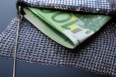 Two hundred Euro bills in a fancy evening bag, horizontal view  photo