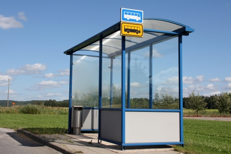 Urban bus stop shelter by road at summer in Salo, Finland  photo