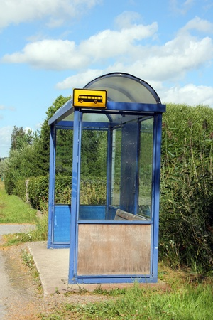Local bus stop shelter by road at summer in Salo, Finland  photo
