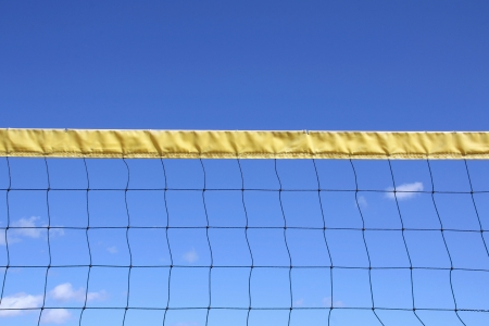 volleyball net: Outdoor volleyball net and blue sky with some clouds at summer  Stock Photo