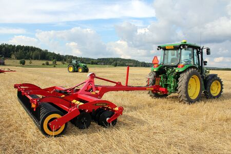 Salo, Finland - August 18, 2012  V�derstad Carrier 400 stubble cultivator and John Deere tractor at Puonti field in Salo, Finland August 18, 2012