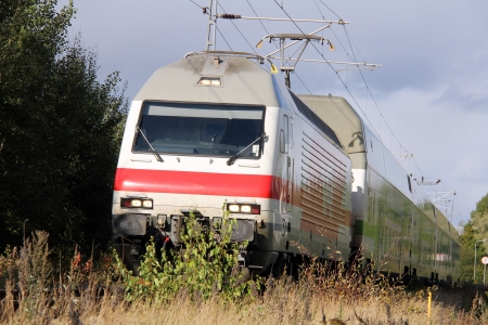 Fast moving modern electric train on a railroad. Stock Photo - 15157045