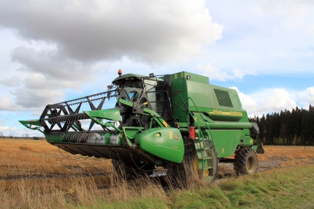 SALO, FINLAND - OCTOBER 8, 2012 - Combine harvester by wet field on October 8, 2012. Heavy rainfall and flooding in area has caused cereal and oleiferous plant crops to be lost. Stock Photo - 15699830