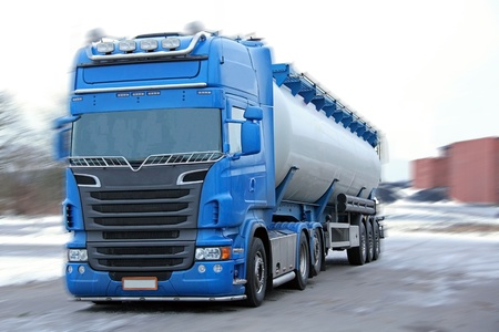 Blue tanker truck with motion blur.