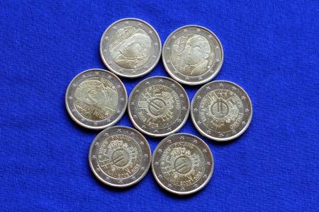issued: Seven Euro coins of two different designs, issued in Finland 2012  Stock Photo