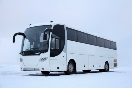 coach bus: White bus in winter snow  Stock Photo