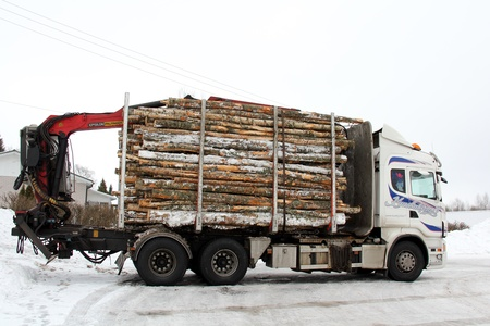 SALO, FINLAND - FEBRUARY 17: Logging truck in Salo, Finland on February 17, 2013. Finnish Forest Industries Federation calls for cost discipline to retain the competitiveness of Finnish forest industry.