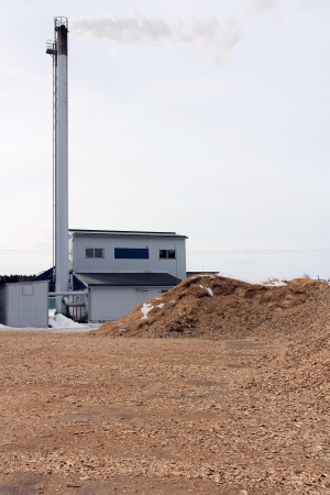 SALO, FINLAND - CIRCA MARCH, 2013: Bio power plant with storage of wood chips in Salo, Finland circa March, 2013. Wood directly or indirectly accounts for as much as a fifth of the energy used in Finland. Editorial