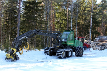 SALO, FINLAND - MARCH 3, 2013   Forest harvester and skidder by logging site in Salo, Finland on March 3, 2013  The EU Timber Regulation  EUTR  which bans illegal wood in the EU came into force on 3rd March 2013