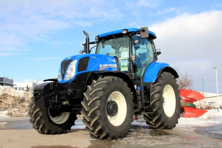 agricultural engineering: SALO, FINLAND - MARCH 23, 2013: Blue modern New Holland agricultural tractor on display in Salo, Finland on March 23, 2013. In Europe, modern agricultural tractors must meet Final Tier 4Stage IV emission standards starting January 2014. Editorial