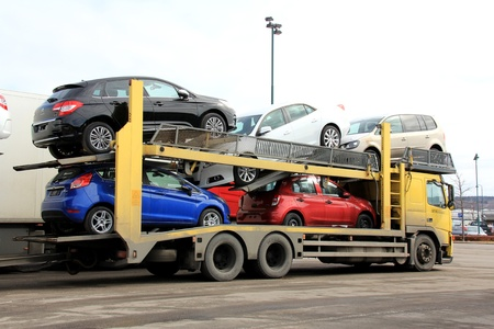 SALO, FINLAND - APRIL 14, 2013: A Car carrier delivering cars in Salo, Finland on April 14, 2013. European car sales fall 10,2% in March 2013 from 3/2012, marking the 18th consecutive month of declines.