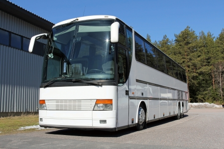 White Coach bus on a parking lot on a sunny day at spring. Stock Photo