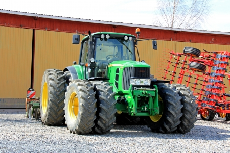 SALO, FINLAND - MAY 4, 2013: A John Deere 6630 Tractor in Salo, Finland on May 4, 2013. For the 7th consecutive year, Deere & Company has been included on Ethisphere Institutes Worlds Most Ethical Companies list.