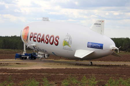 nt: JAMIJARVI, FINLAND - MAY 12, 2013: Pegasos Zeppelin NT airship in Jamijarvi, Finland on May 12, 13. Scientist conduct research in area as part of PanEuropean GasAeroSOls-climate interaction Study.