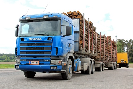 SALO, FINLAND - MAY 25, 13: A Scania 420 logging truck in Salo, Finland on May 26, 13. In Finland, the demand for timber stays high, and weekly sales are soon expected to reach 1 Million cubic metres.