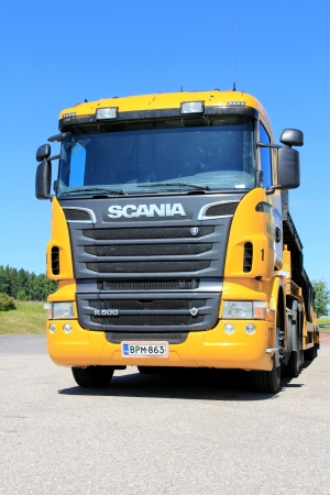 SALO, FINLAND - JUNE 21, 2013: Scania R500 Vehicle carrier parked in Salo, Finland on June 21, 2013.  According to press release dated June 20, Scania delivers worlds first Euro 6 gas truck to customer.
