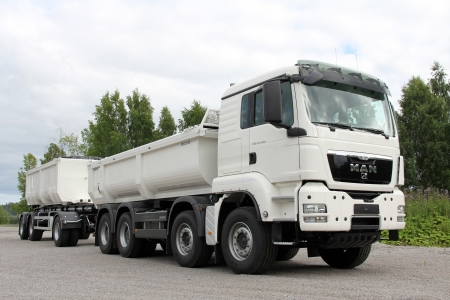 stringent: KARJAA, FINLAND - JULY 7, 2013: MAN TGS 35.480 Heavy duty truck parked in Karjaa, Finland on July 7, 13. MAN heavy duty trucks use SCR technology to satisfy the Euro 5 standard as well as the more stringent, optional EEV exhaust emissions standard. Editorial