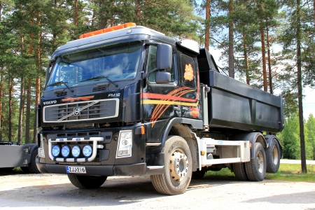 TAMMISAARI, FINLAND - JULY 6, 2013: Volvo FM12 heavy duty truck parked in Tammisaari, Finland on July 6, 2013. D13K460 is Volvos first engine to meet the demands of new Euro 6 emission regulation coming into force in 2014. Stock Photo - 20711607