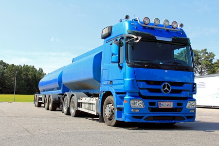 SALO, FINLAND - JULY 14, 2013: Mercedes Benz truck and full trailer parked in Salo, Finland. To meet the stringent Euro VI emission standards, Mercedes Benz combines SCR, EGR and DPF technologies.