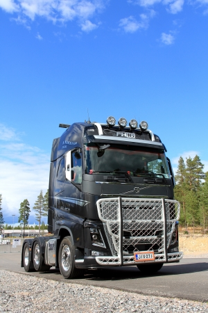 TAMMISAARI, FINLAND � JULY 20, 2013: New Volvo FH16 600 Truck parked in Tammisaari, Finland on July 20. Volvo Trucks announces plans to commercialize dimethyl ether (DME)-powered heavy-duty commercial vehicles in North America. Stock Photo - 21038826