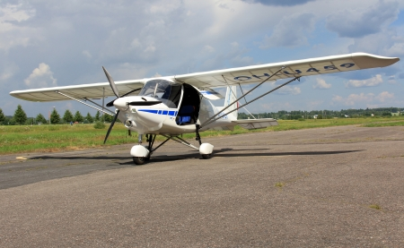 airplane ultralight: FORSSA, FINLAND - JULY 28, 2013: An ultralight Icarus C42 plane having landed on Forssa Airfield on July 28, 2013. In Europe, the definition of ultralight or microlight is an aeroplane having 2 seats maximum, maximum stall speed (VS0) of 35 knots (65 kmh