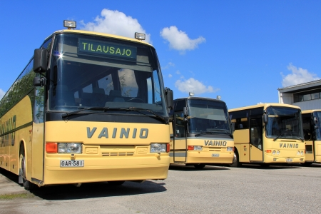 complied: SALO, FINLAND -  JULY 27, 2013: Yellow buses parked Salo, Finland on July 27,  2013. With the Euro 6 regulation, manufacturers are responsible for ensuring that the required exhaust gas emission limits of their commercial vehicles are actually complied wi