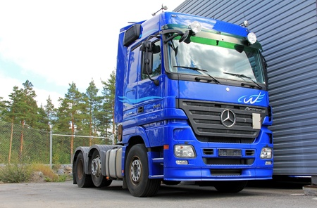 LIETO, FINLAND - AUGUST 3   Blue Mercedes-Benz Actros 2546 truck in Lieto, Finland on August 3, 2013  Mercedes-Benz starts second half of 2013 with its best-ever July and 20  growth in sales