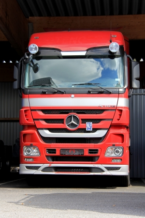 daimler: LIETO, FINLAND - AUGUST 3  Red Mercedes Benz Actros truck in Lieto, Finland on August 3, 2013  In the Interim Report Q2 2013, Daimler Group plans to achieve slight growth in Daimler Trucks unit sales in this year