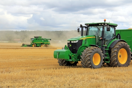 SALO, FINLAND - AUGUST 10  John Deere 7280R Agricultural Tractor and Modern Combine Harvester T560 displayed at the annual Puontin Peltopaivat Agricultural Show in Salo, Finland on August 10, 2013