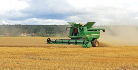 SALO, FINLAND - AUGUST 10  John Deere Combine s670i harvesting barley at the annual Puontin Peltopaivat Agricultural Show in Salo, Finland on August 10, 2013