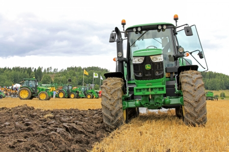 deere: SALO, FINLAND - AUGUST 10  John Deere 6150M agricultural tractor and plow at the annual Puontin Peltopaivat Agricultural Show in Salo, Finland on August 10, 2013