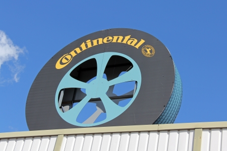 ag: FORSSA, FINLAND - AUGUST 11: Sign Continental inside a tire on August 11, 2013 in Forssa, Finland. Continental AG is a leading German auto and truck parts manufacturing company founded in 1871.