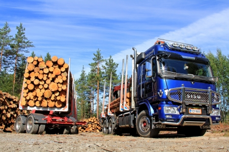 TENHOLA, FINLAND - AUGUST 24: Sisu Polar logging truck and trailer on August 24, 2013 in Tenhola, Finland. Internationalforestindustries.com predicts a price spike in lumber in  2013-2014 due to increased demand.