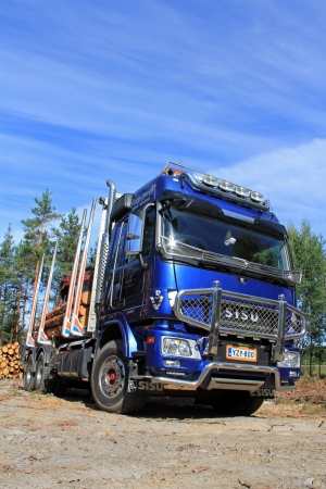 logging truck: TENHOLA, FINLAND - AUGUST 24: Sisu Polar logging truck on August 24, 2013 in Tenhola, Finland. Timo Korhonen takes over the whole ownership of Sisu Auto, by increasing his shares from previous 50% to 100%.