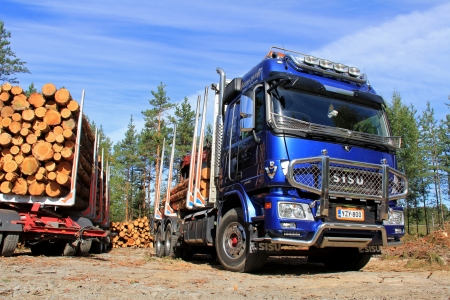 logging truck: TENHOLA, FINLAND - AUGUST 24: Sisu Polar logging truck and trailer on August 24, 2013 in Tenhola, Finland. Internationalforestindustries.com predicts two price spikes in lumber, 2013-2014 and 2016-17, due to increasing demand. Editorial