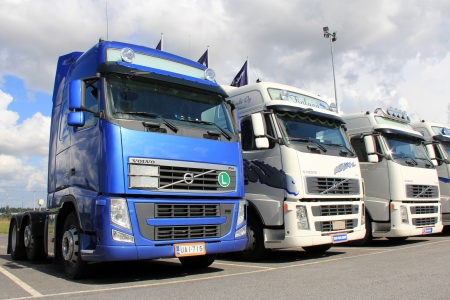 LIETO, FINLAND - AUGUST 31  Row of Volvo trucks on August 31, 2013 in Lieto, Finland  According to Volvo Group, one third of all goods traffic on the European roads involves the transport of food  Editorial