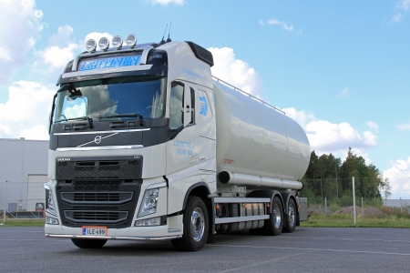 involves: LIETO, FINLAND - AUGUST 31  Volvo FH food transport truck on August 31, 2013 in Lieto, Finland  According to Volvo Group, one third of all goods traffic on the European roads involves the transport of food