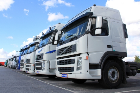 LIETO, FINLAND - AUGUST 31: Volvo FH trucks on August 31, 2013 in Lieto, Finland. Volvo Trucks new range goes on public display for the first time at the Comtrans Exhibition in Moscow 10–14 September.