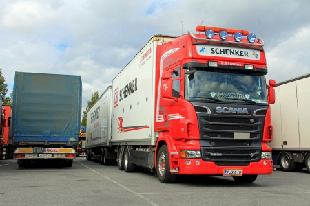 TURKU, FINLAND - SEPTEMBER 15: Scania R500 V8 truck with DB Schenker trailer on September 15, 2013 in Turku, Finland. DB Schenker land transport is the leading ground forwarding network in Europe with 720 branches in 36 European countries. Stock Photo - 22234060