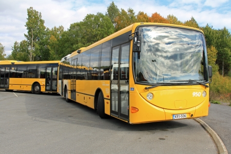 omnibus: TURKU, FINLAND - SEPTEMBER 15: Yellow city buses on September 15, 2013  in Turku, Finland. European Commission launches 2013 EU Sustainable Urban Mobility Plan award for cities in member area.