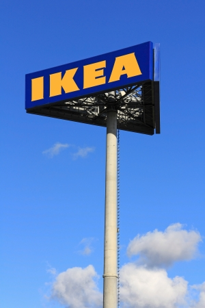 RAISIO, FINLAND – SEPTEMBER 21: IKEA sign board against sky at IKEA Raisio Store on September 21, 2013 in Raisio, Finland. The Swedish company founded by Ingvar Kamprad  is the worlds largest furniture retailer. Stock Photo - 22358774