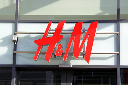 hm: SALO, FINLAND - OCTOBER 6: Sign H&M on  H&M Store wall on October 6, 2013 in Salo, Finland.  H & M Hennes & Mauritz AB (H&M), is a Swedish clothing company with more than 1400 stores in 28 different countries.