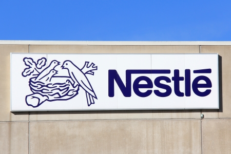 TURKU, FINLAND - OCTOBER 6: Sign Nestle at Suomen Nestle Factory on October 6, 2013 in Turku, Finland. Nestle S.A. is a Swiss multinational food and beverage company, and the largest food company in the world measured by revenues.