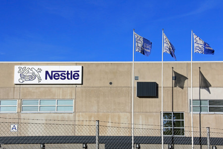 TURKU, FINLAND - OCTOBER 6:  Suomen Nestle Factory  on October 6, 2013 in Turku, Finland. Of Finlands two Nestle factories, Turku manufactures baby food. Stock Photo - 22688664