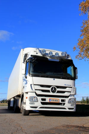 KOSKI, FINLAND - OCTOBER 20: White Mercedes-Benz Actros truck with trailer parked on October 20, 2013 in Koski, Finland. MB Actros wins Irelands first Truck of the Decade award. Stock Photo - 22948337