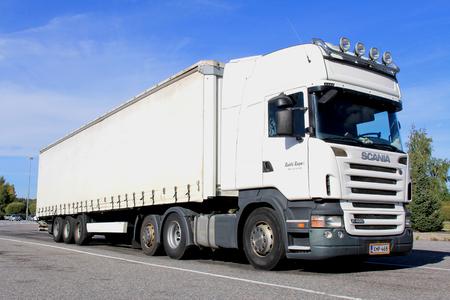 emergency braking: TURKU, FINLAND - SEPTEMBER 7  White Scania R480 trailer truck on  September 7, 2013 in TURKU, Finland  Scanias Advanced Emergency Braking system helps truck drivers avoid accidents