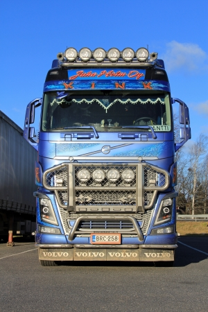 logging industry: FORSSA, FINLAND - NOVEMBER 17: Blue Volvo FH16 logging truck on November 17, 2013 in Forssa, Finland. Volvo Trucks wins Top Telematics Industry Honors for Remote Diagnostics.